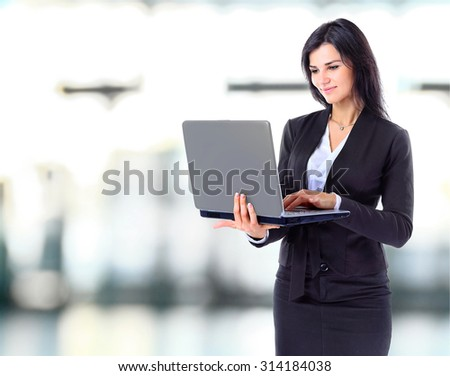 Businesswoman working at a laptop full length isolated on white background - stock photo