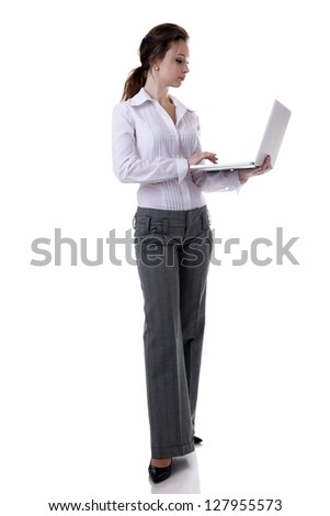 Businesswoman working at a laptop full length isolated on white background studio shot