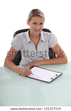 businesswoman working at her desk - stock photo