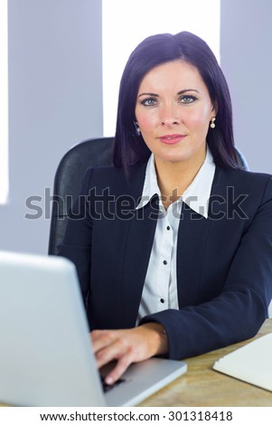 Businesswoman working at her desk in her office