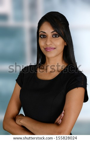 Businesswoman working at her office by herself - stock photo