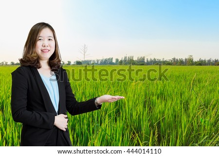 Businesswoman working at her office by herself on Rice background. - stock photo