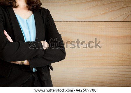 Businesswoman working at her office by herself on Wood background. Can use for product display - stock photo