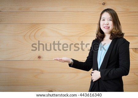 Businesswoman working at her office by herself on Wood background.Can use for product display - stock photo