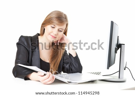businesswoman working at the desk with papers and  computer, white background