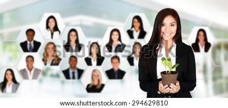 Businesswoman working in an office with her team - stock photo