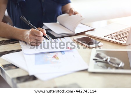 Businesswoman working in office.
