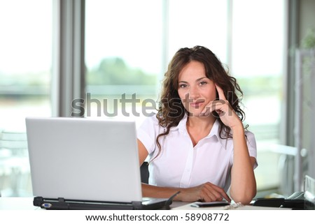 Businesswoman working in the office - stock photo