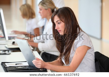 Businesswoman working in the office on electronic pad - stock photo