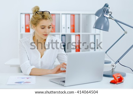 Businesswoman working office - stock photo