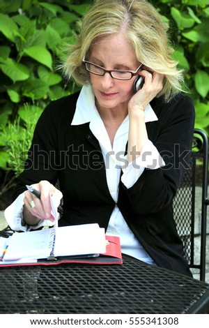 Businesswoman working on a project outdoors.
