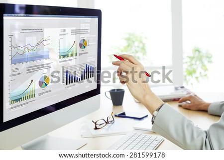 Businesswoman working on computer - stock photo
