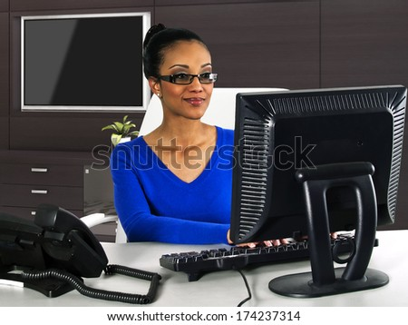 businesswoman working with a computer in the office - stock photo