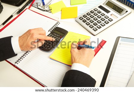 Businesswoman working with calculator in the office