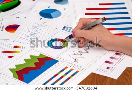 businesswoman working with graphs and charts. - stock photo
