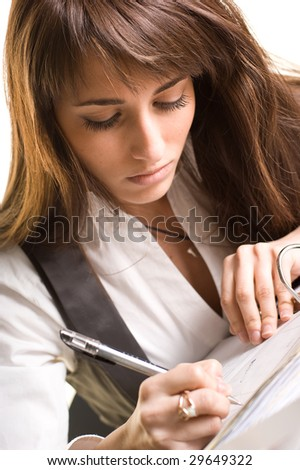 Businesswoman working with invoice