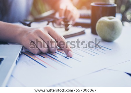Businesswoman working with sheet analysis charts.