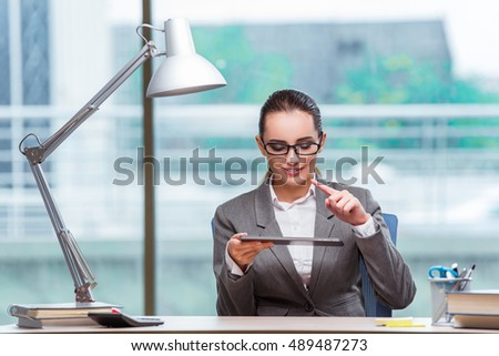 Businesswoman working with tablet computer in business concept