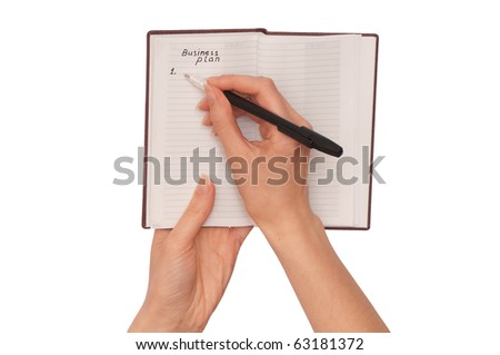 businesswoman writes a business plan for creation new business - stock photo