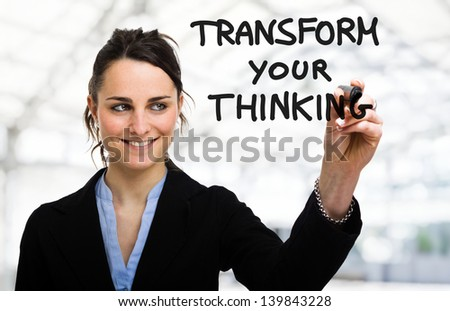 Businesswoman writing a motivational concept on the screen - stock photo