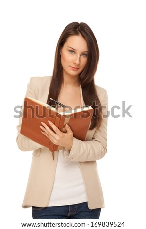 Businesswoman writing in her notebook