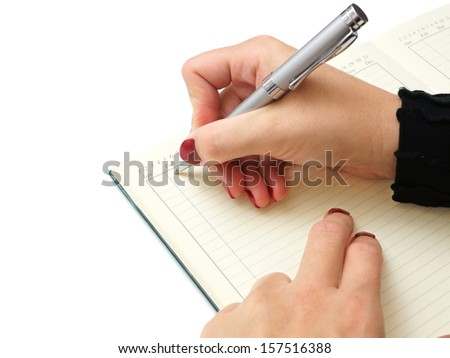 businesswoman writing in her notepad - stock photo