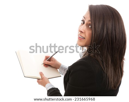Businesswoman writing in personal organizer - stock photo