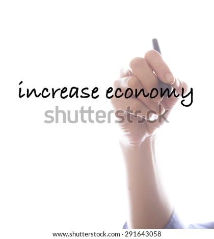 Businesswoman writing increase economy ,white background,business background - stock photo