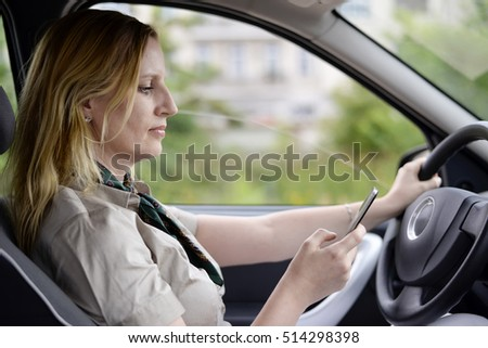 businesswoman writing message in the car