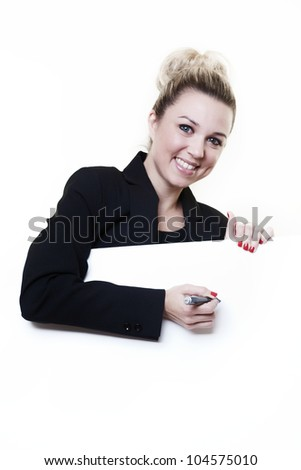 businesswoman writing with a maker pen on white card in front of her - stock photo