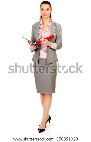 Businesswoman writing with big pencil.