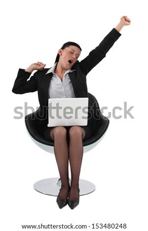 Businesswoman yawning - stock photo