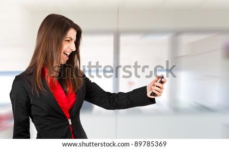 Businesswoman yelling at phone - stock photo