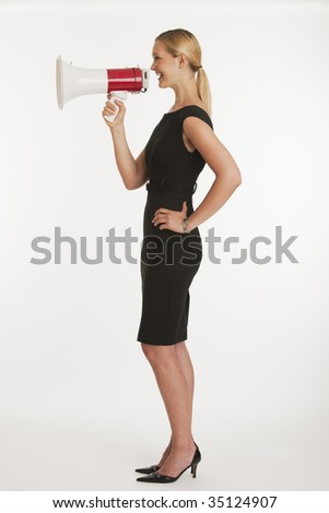 businesswoman yelling into megaphone with white seamless background