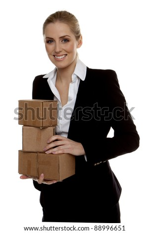 Businesswoman. Young successful businesswoman holding small boxes ready for shipment.