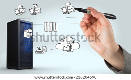 Businesswomans hand writing with marker against digitally generated black server tower - stock photo