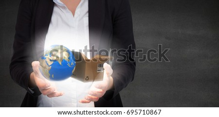Businesswomans hands presenting against black wall