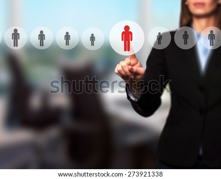 Businesswomen Hand select New Employee from Electronic interface using for Business technology, internet, networking, Recruitment and Workforce Concept. Isolated on office. Stock Image - stock photo