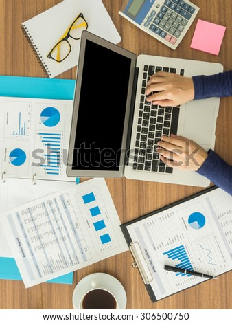 businesswomen hand working with digital laptop computer on wooden desk in office. top view - stock photo