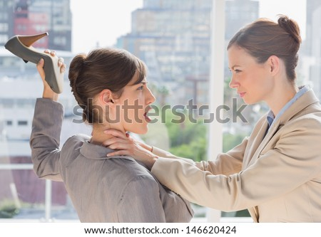 Businesswomen having a violent fight - stock photo