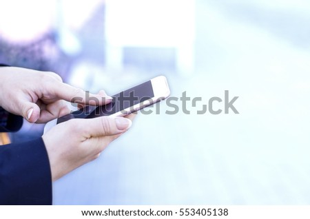 Businesswomen holding generic design phone with blank scree