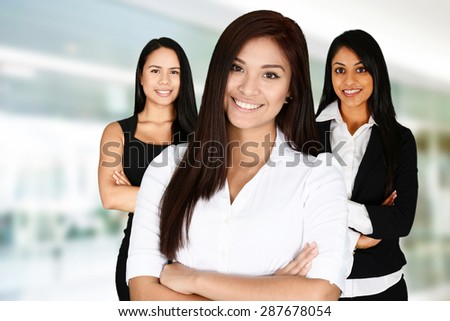 Businesswomen of all races working together in an office - stock photo