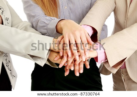 Businesswomen putting their hands together, isolated on white