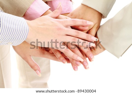 Businesswomen putting their hands together, isolated on white, closeup - stock photo