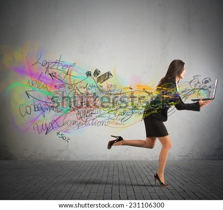 Businesswomen run with her projects in laptop - stock photo