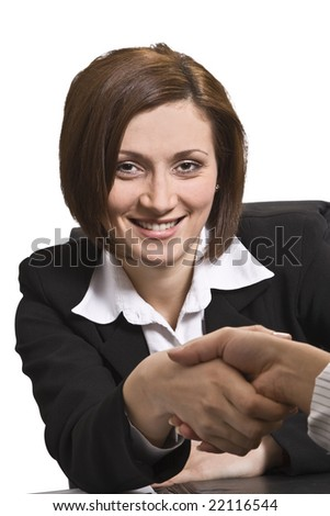 Businesswomen shaking hands in the office.