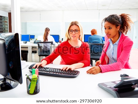 Businesswomen team working at offcce desk with computer multi ethnic teamwork - stock photo