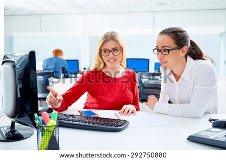 Businesswomen team working at office desk with computer teamwork - stock photo