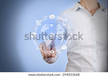 Businesswomen Touch World and Social Network Concept  - stock photo