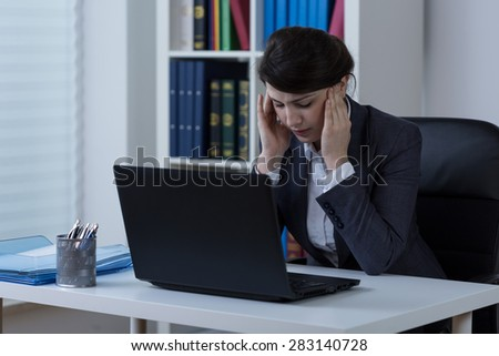 Businesswomen with headache during work - stock photo